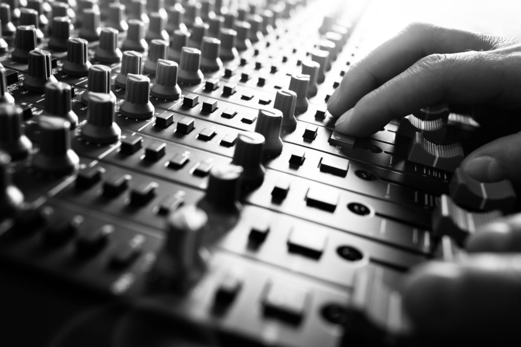 mixing desk being adjusted