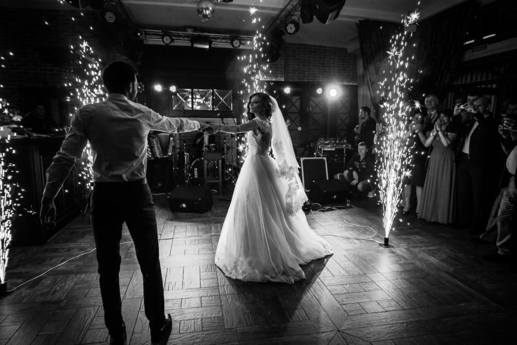 Newlywed couple performing their first dance with a live band